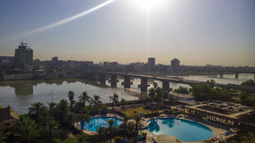 Baghdad at Sunrise. Baghdad, Iraq – August 21 2014 : Aerial photographs of the city of Baghdad during Sunrise ,And shows where residential complexes and the Royalty Free Stock Images