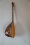 Baglama turkish musical instrument. On the wall Stock Images