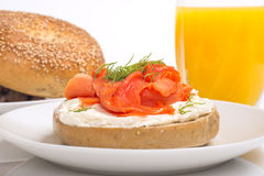 Bagle with cream cheese, salmon and orange juice Stock Images