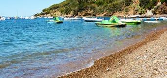 Bagnaia Portoferraio bay, landscape and reef, Elba Island. Bagnaia Portoferraio bay, landscape, reef, boats and coastline, romantic landscape and rocks. Elba royalty free stock photography