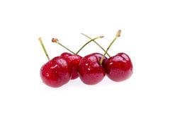 Bagni le ciliege su bianco Fotografie Stock