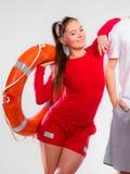 Bagnino della ragazza con attrezzatura di soccorso Immagine Stock