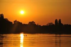 Bagno su un tramonto Fotografia Stock