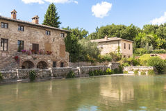 Bagno Vignoni, Tuscany, Italy. Bagno VIgnoni, medieval town in Tuscany. The heart of the village with the  Square of sources, a rectangular tank with the Stock Photography