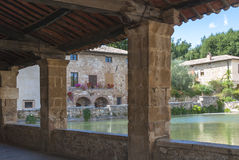 Bagno Vignoni, Tuscany, Italy. Bagno VIgnoni, medieval town in Tuscany. The heart of the village with the Square of sources, a rectangular tank with the stock photos