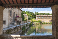 Bagno Vignoni, Tuscany, Italy. Bagno VIgnoni, medieval town in Tuscany. The heart of the village with the Square of sources, a rectangular tank with the stock image