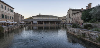 BAGNO VIGNONI, TUSCANY ITALY - October 30, 2016: Undefined people in the old thermal baths in the medieval village Bagno Vignoni Royalty Free Stock Photography