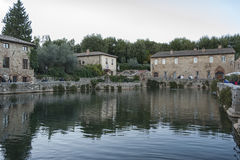BAGNO VIGNONI, TUSCANY ITALY - October 30, 2016: Undefined people in the old thermal baths in the medieval village Bagno Vignoni Stock Photos