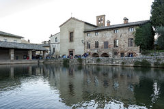 BAGNO VIGNONI, TUSCANY ITALY - October 30, 2016: Undefined people in the old thermal baths in the medieval village Bagno Vignoni Stock Images