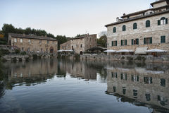 BAGNO VIGNONI, TUSCANY ITALY - October 30, 2016: Undefined people in the old thermal baths in the medieval village Bagno Vignoni Royalty Free Stock Photo
