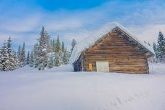 Bagnsasen, Norway - April, 02, 2018: Outdoor view with lonely wooden house covered with heavy snow. In Bagnsasen region in Norway Stock Image