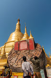 Bago, Myanmar-February 21,2014: Shwemawdaw pagoda. Bago, Myanmar -February 21, 2014:  Travelers are looking  at old ruin and try to compare with rebuilt  of Royalty Free Stock Image