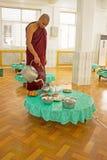 BAGO, MYANMAR - November 26, 2015: Monk serving tea in the monas Royalty Free Stock Photo