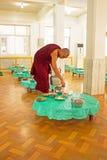 BAGO, MYANMAR -November 26, 2015: Monk serving tea in the monast Royalty Free Stock Image