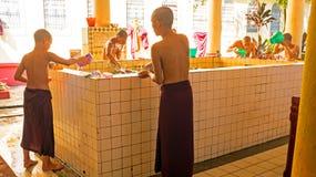 BAGO, MYANMAR -November 26, 2015: Monks in the bathroom Royalty Free Stock Image