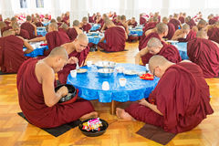 BAGO, MYANMAR -November 26, 2015: Monks having lunch in the mona Royalty Free Stock Photos