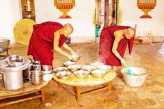 BAGO, MYANMAR -November 26, 2015: Monks preparing lunch in the m Royalty Free Stock Image