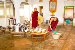 BAGO, MYANMAR -November 26, 2015: Monks preparing lunch in the monastry Royalty Free Stock Image