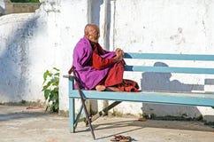 BAGO, MYANMAR - November 24, 2015: Old monk enjoying the sun in Stock Photography