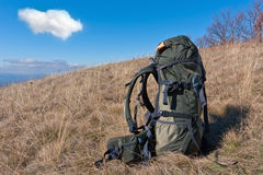 Bagpack on meadow Stock Photo