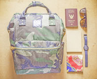 Bagpack with passport, notebook, watch, sunglasses. Bagpack with passport, notebook, watch, sunglasses and handkerchief on wooden table Stock Photos