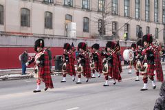 Bagpipe band marches in Hartford, Connecticut`s St. Patrick`s Day parade royalty free stock photos