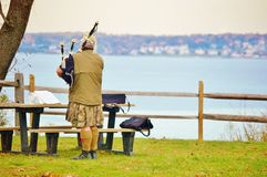 Bagpipe  player rehearsal  in park Stock Images