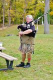 Bagpipe  player rehearsal  in park Stock Photos