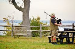Bagpipe  player rehearsal  in park Royalty Free Stock Photography
