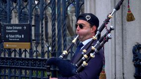 Bagpipe player in the Streets of London - LONDON, ENGLAND - DECEMBER 10, 2019
