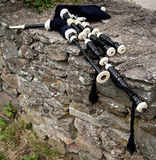 Bagpipe on a Stone Wall Stock Photos