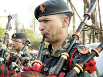 Bagpiper. A Nepali Army man playing bagpiper in a ceremony. Bagpipes are frequently used during funerals and memorials, especially among the military and police Royalty Free Stock Images