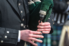 Bagpiper in action Stock Image