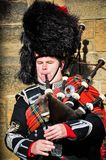 Bagpiper. A bagpiper on the royal mile stock image