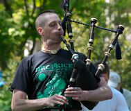 Bagpiper Don of Nae Regrets playing 4 Stock Photos