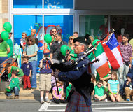 Bagpiper with Flags Royalty Free Stock Image