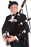 Bagpiper in geruite Schotse wollen stof Stock Foto