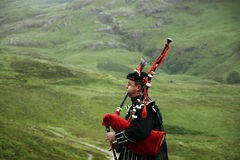 Bagpiper in Glencoe - Scottish Highlands Stock Images