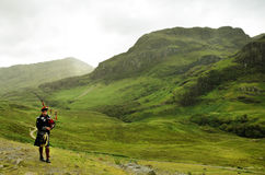 Bagpiper in Glencoe - Scottish Highlands Royalty Free Stock Image