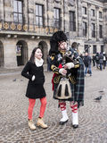 Bagpiper with his bagpipe in the square Stock Photo