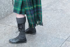 Bagpiper in Kilt and Sporran. Scottish bagpiper in kilt sporran and brogues royalty free stock image