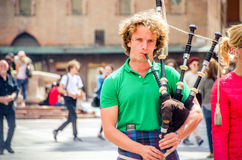 Bagpiper perform buskers street artists Stock Photos