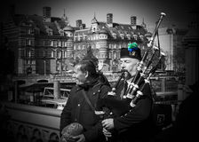 Bagpiper performs music on the Westminster bridge, London, Unite Stock Photography