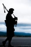 Bagpiper playing music Royalty Free Stock Photography
