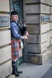 Bagpiper. On royal mile in edinburgh Stock Photo