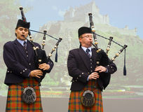 Bagpipers. In kilts with Edinburgh Castle in background Royalty Free Stock Image