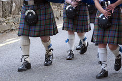 Bagpipers. Traditional bagpipe band marching down the street Royalty Free Stock Photos