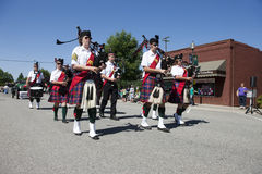 Bagpipers and drummers in parade. Stock Photo