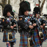 Bagpipers of Nassau Police Pipes and Drums marching at the St. Patrick's Day Parade Royalty Free Stock Images