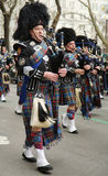 Bagpipers of Nassau Police Pipes and Drums marching at the St. Patrick's Day Parade Stock Photos